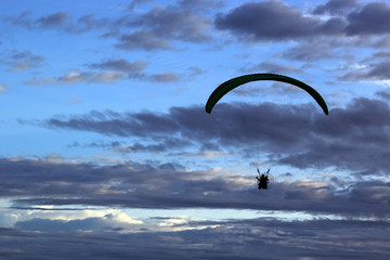 silhouette of paragliding on beautiful sky background