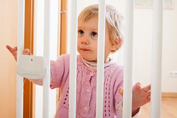 Girl near stair gate