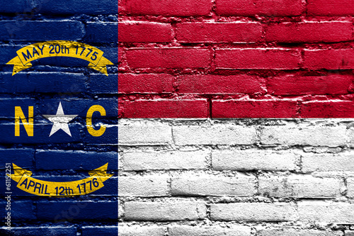 North Carolina State Flag painted on brick wall
