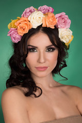 Beautiful young woman with flower wreath. Fashion shot. Portrait