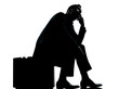 one business man sitting on suitcase waiting silhouette