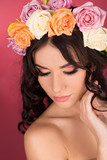 Beautiful young woman with floral wreath. Fashion shot.