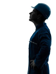 man construction worker looking up profile silhouette portrait
