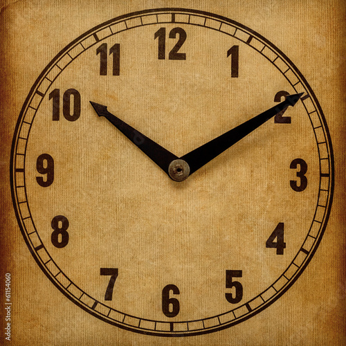 Textured old paper clock face showing 10:10
