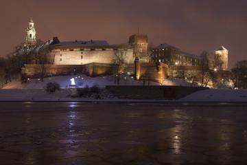 Poland, Krakow, Snow Covered Wawel Royal Castle Lit-up