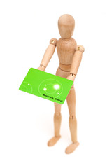 wooden man holding a bonus card