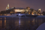 Poland, Krakow, Snow Covered Wawel Royal Castle Lit-up