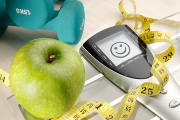 healthy apple and sport and happy face message