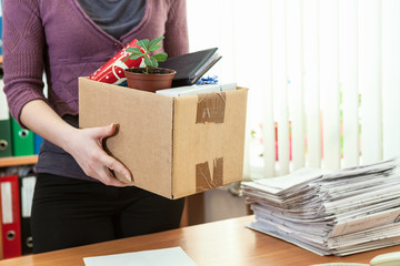 Unrecognizable office employee with collected in box things