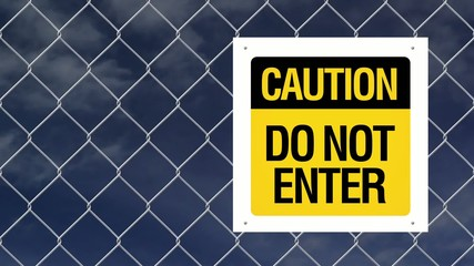 Caution sign - Do not enter on chain link fence