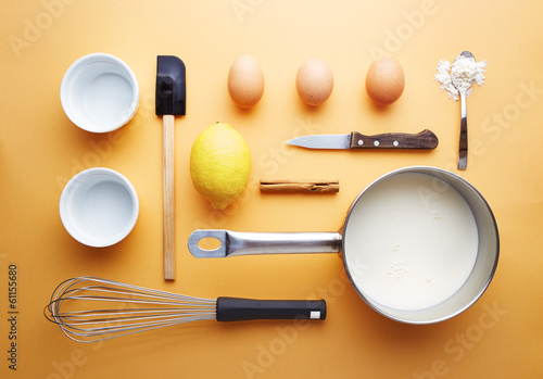 Creme brulee ingredients on yellow background