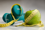 Fototapety healthy apple, measuring tape and dumbbells