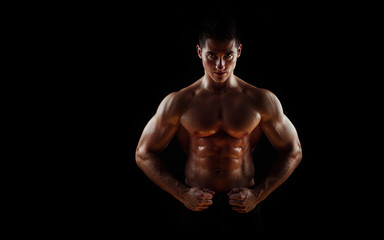 Man with muscular torso isolated on black background,  male tors