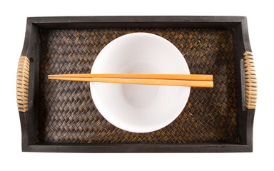 A pair of chopstick and and a bowl