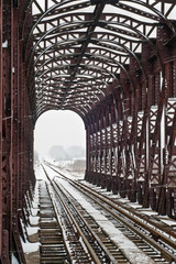 iron railway bridge in winter