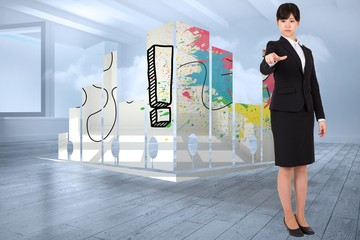 Composite image of focused businesswoman pointing