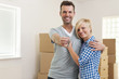 Happy couple in love with key to new home