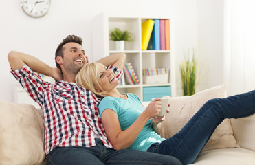 Happy couple relaxing together at home