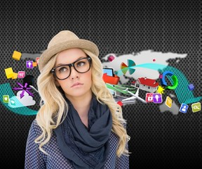 Composite image of serious trendy blonde with classy glasses