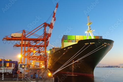 Leinwandbild Motiv Container Cargo freight ship with working crane bridge