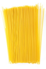 Uncooked Italian spaghetti on a white background