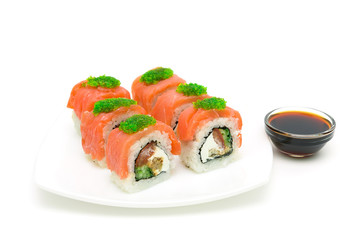 Japanese rolls and soy sauce isolated on a white background