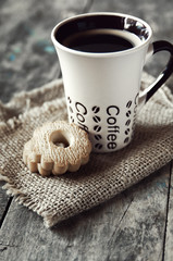 coffee and cookies on vintage wooden background