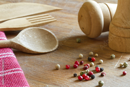 Peppers spice and wooden kitchenware with cutlery