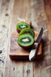 Halved Kiwi Fruit on a Chopping Board