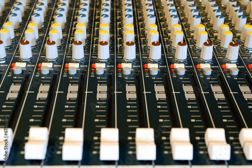 Audio mixer in studio with many buttons