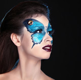 Face art portrait. Fashion Make up. Butterfly makeup on face bea