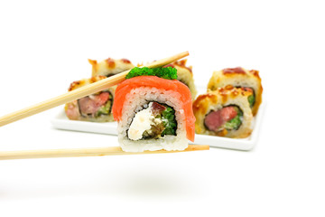 Japanese cuisine - rolls on white background