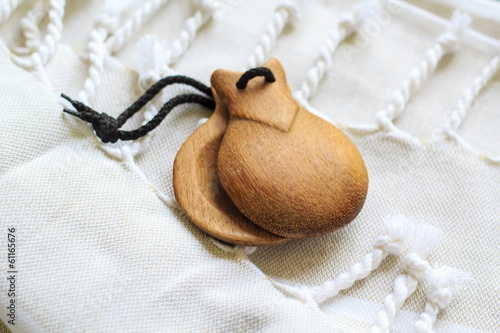 Castanets on a white tissue background