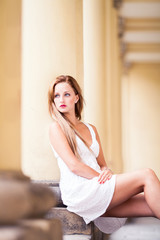 Beautiful woman wearing white dress