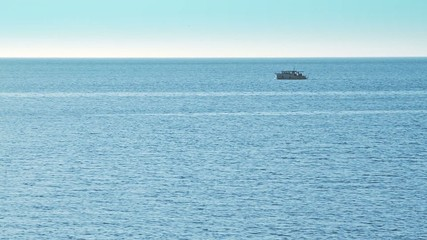 Open sea with ship on the horizon