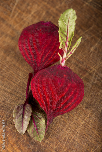 beet with leaves on a wooden background