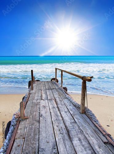 Fotobehang Een Hoekje om te Dromen el embarcadero de la playa tropical
