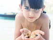 Girl holding seashell