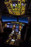 Fototapety Cockpit of aircraft in a night flight