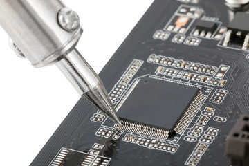 Close up of electronic circuit board with several semiconductors