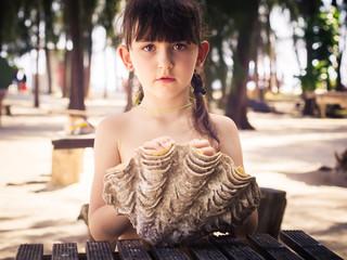 Girl holding seashell