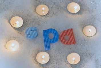 Spa letters with candles