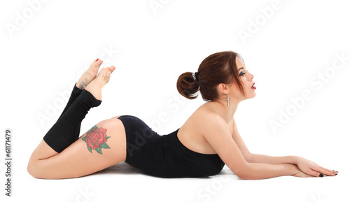 Tattooed athletic beautiful girl on fitness training