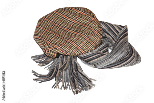 Retro-styled gentlemen`s tweed cap and scarf isolated
