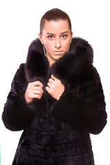 Beautiful Woman in black Fur Coat. isolated