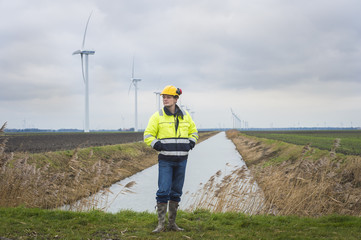 Project developer in a green landscape with windmills