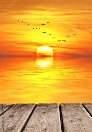 Fotobehang Een Hoekje om te Dromen puesta de sol sobre el mar