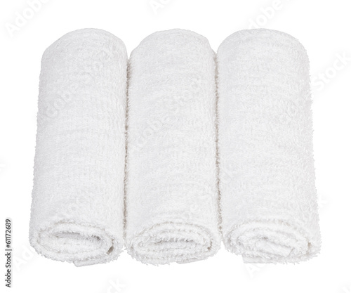 rolled up towels on white background