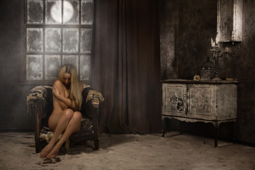 Naked girl in a mystical snowy interior