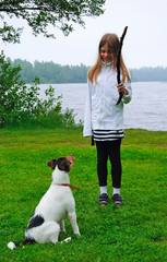 Young child girl trains the dog